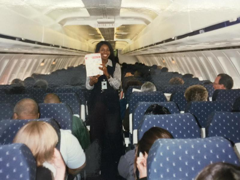 Henderson aboard an AirTrain flight during training for her time as a flight attendant for the airline in 2004. (Photo: Lanelle Henderson)