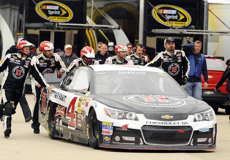 Kevin Harvick (4) is pushed to the garage by his crew during the NASCAR Sprint Cup Series auto race at Texas Motor Speedway, Monday, April 7, 2014, in Fort Worth, Texas.  Harvick left the race after 28 laps due to a blown engine