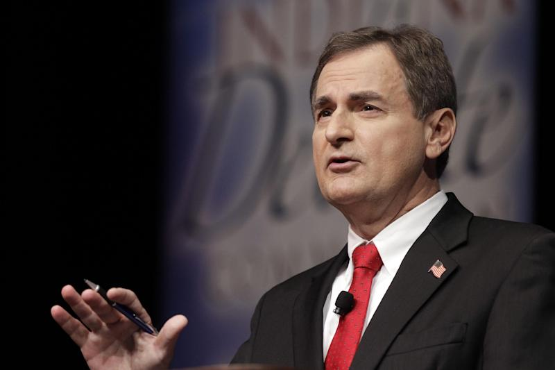 """Republican Richard Mourdock, candidate for Indiana's U.S. Senate seat, participates in a debate with Democrat Joe Donnelly and Libertarian Andrew Horning in a debate in New Albany, Ind., Tuesday, Oct. 23, 2012. Mourdock said Tuesday when a woman is impregnated during a rape, """"it's something God intended."""" He was asked during the final minutes of the debate whether abortion should be allowed in cases of rape or incest. (AP Photo/Michael Conroy)"""
