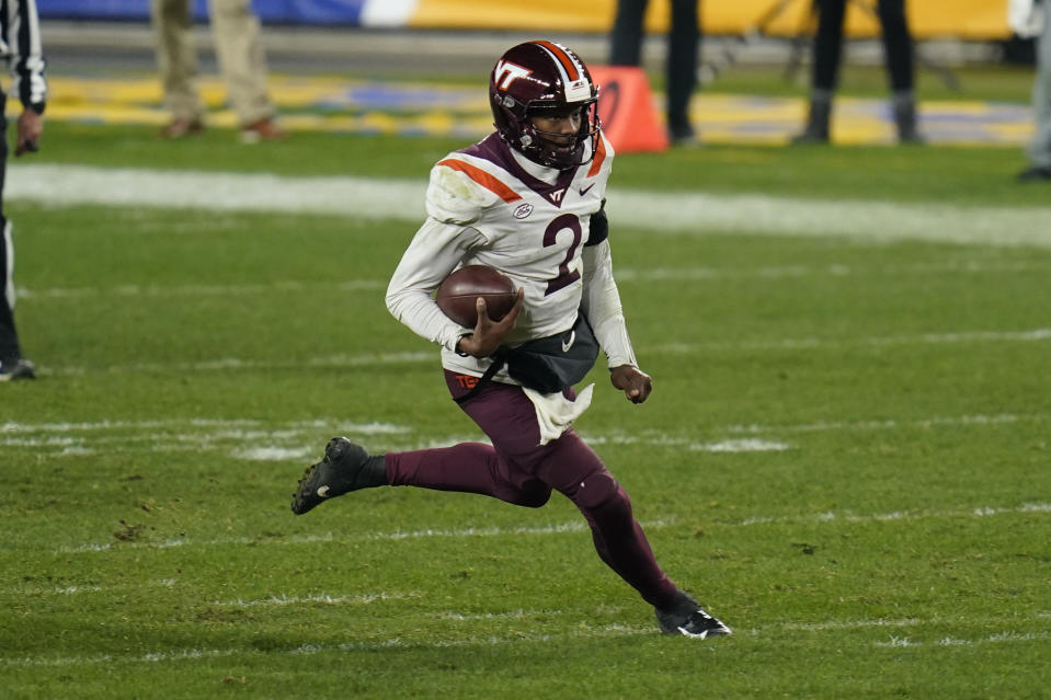 Virginia Tech quarterback Hendon Hooker (2) plays against Pittsburgh in an NCAA college football game, Saturday, Nov. 21, 2020, in Pittsburgh. (AP Photo/Keith Srakocic)