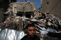 Syrian refugee Ahmed Staifi poses for a picture in front of the house were his wife and two of his daughters were killed following a massive explosion