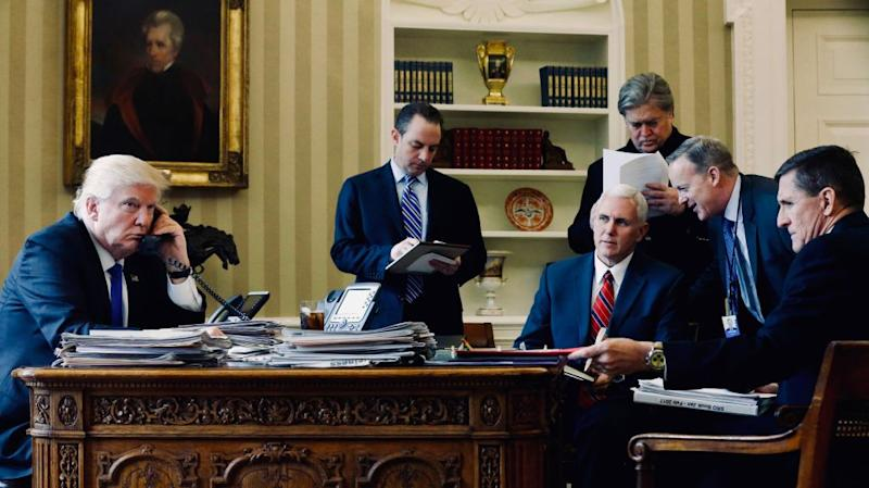 Trump on the phone with Putin, surrounded by advisers.