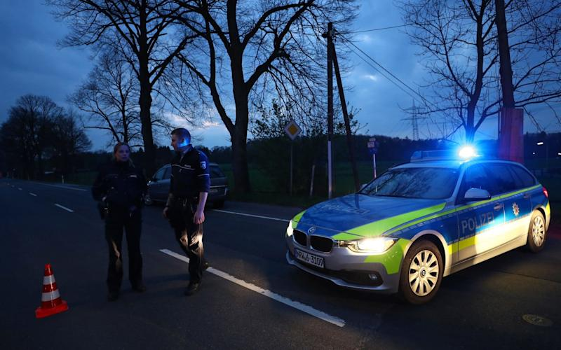 Police road block near the Borussia Dortmund team hotel - Credit: Kai Pfaffenbach/Reuters