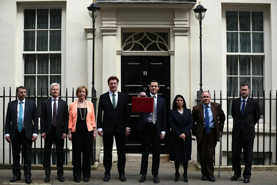 LONDON, ENGLAND - MARCH 18: (L-R) Gareth Johnson, Lord Deighton, Andrea Leadsom MP, Danny Alexander MP, The Chancellor of the Exchequer George Osborne, Priti Patel MP, Rob Halfon and David Gauke MP leave 11 Downing Street on March 18, 2015 in London, England. The Chancellor is presenting his 5th Budget to Members of Parliament today, the last before the General Election on May 7, 2015. (Photo by Dan Kitwood/Getty Images)