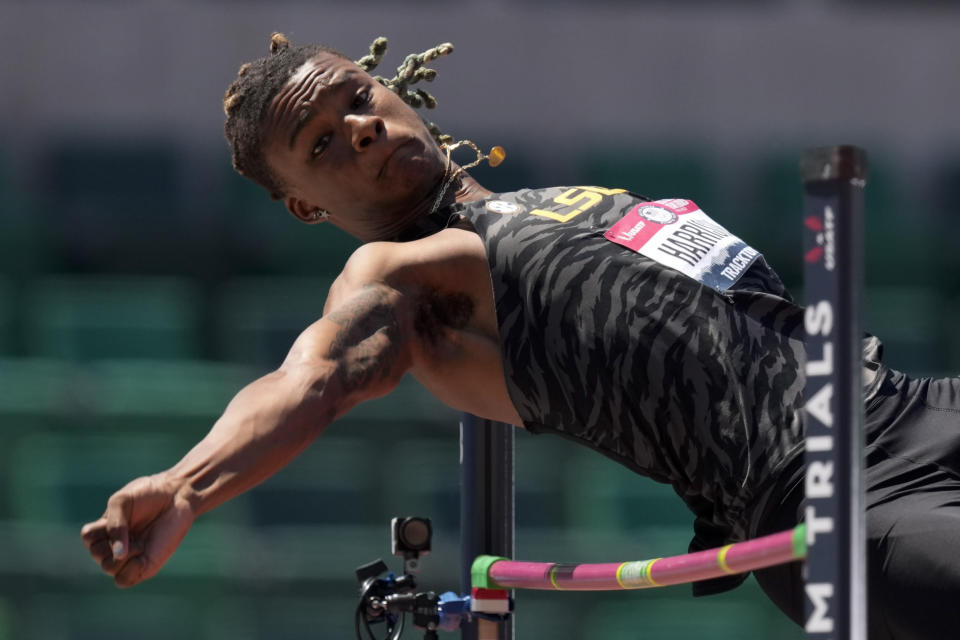 FILE - In this June 27, 2021, file photo, JuVaughn Harrison competes during the finals of the men's high jump at the U.S. Olympic Track and Field Trials in Eugene, Ore. Harrison will compete at the Tokyo Games in the long jump and the high jump. Not since the days of Jim Thorpe in 1912 has an American man made the team in those two events at one Olympics. (AP Photo/Charlie Riedel, File)