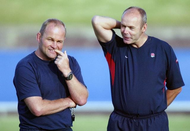 Andy Robinson (left) succeeded Clive Woodward (right) as England head coach
