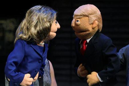 Puppets in the likeness of Democratic presidential nominee Hillary Clinton and Republican presidential nominee Donald Trump face-off after a mock Avenue Q sponsored debate in the Manhattan borough of New York