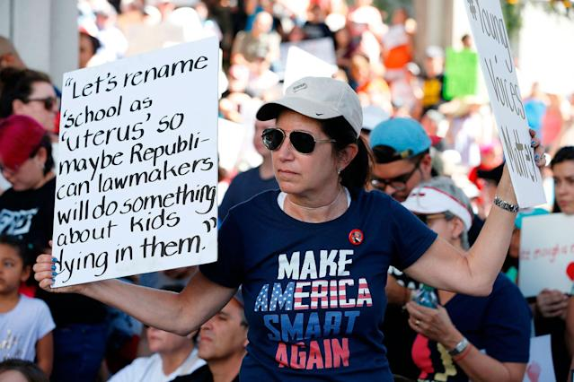 <p>Protesters hold signs at a gun control at the Broward County Federal Courthouse in Fort Lauderdale, Fla., on Feb. 17, 2018. (Photo: Rhona Wise/AFP/Getty Images) </p>