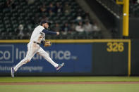 Seattle Mariners shortstop J.P. Crawford makes a leaping throw to get Baltimore Orioles' Chance Sisco out on a ground out play to first with the bases loaded to end the top of the sixth inning of a baseball game, Tuesday, May 4, 2021, in Seattle. (AP Photo/Ted S. Warren)