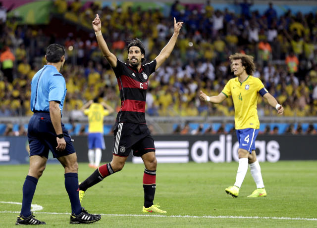 Germany's Sami Khedira celebrates after scoring his side's fifth goal during the World Cup semifinal soccer match between Brazil and Germany at the Mineirao Stadium in Belo Horizonte, Brazil, Tuesday, July 8, 2014. (AP Photo/Natacha Pisarenko)