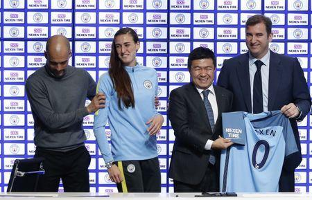 Britain Football Soccer - Manchester City announce sleeve partnership - City Football Academy - 17/3/17 Manchester City manager Pep Guardiola, Jill Scott, Nexen Tire CEO Travis Kang and chief executive Ferran Soriano during the announcement of a partnership with Nexen Tire Action Images via Reuters / Ed Sykes Livepic