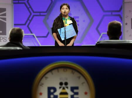 Khushi Jeswani of Ghana spells her word before the judges during round two of the preliminaries at the Scripps-Howard National Spelling Bee at National Harbor, Maryland May 28, 2014. REUTERS/Gary Cameron