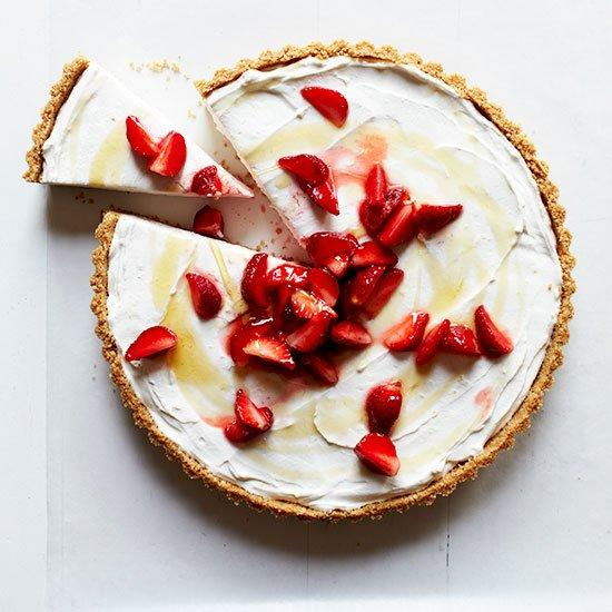 """<p>For this elegant, no-bake cheesecake, Nicolaus Balla ferments his own farmer's cheese (a kind of cottage cheese). Ricotta mixed with cream cheese makes a delicious substitute for the filling, which is incredibly light, delicately sweet and wonderful inside the crumbly graham cracker crust.</p><p><a href=""""https://www.foodandwine.com/recipes/farmers-cheesecake-strawberries"""">GO TO RECIPE</a></p>"""