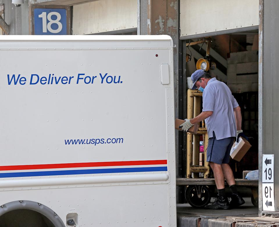 BOSTON, MA. - AUGUST 11 A post office worker loads his truck at the United States Post Office annex on August 11, 2020 in Boston, Massachusetts.   (Staff Photo By Matt Stone/ MediaNews Group/Boston Herald)