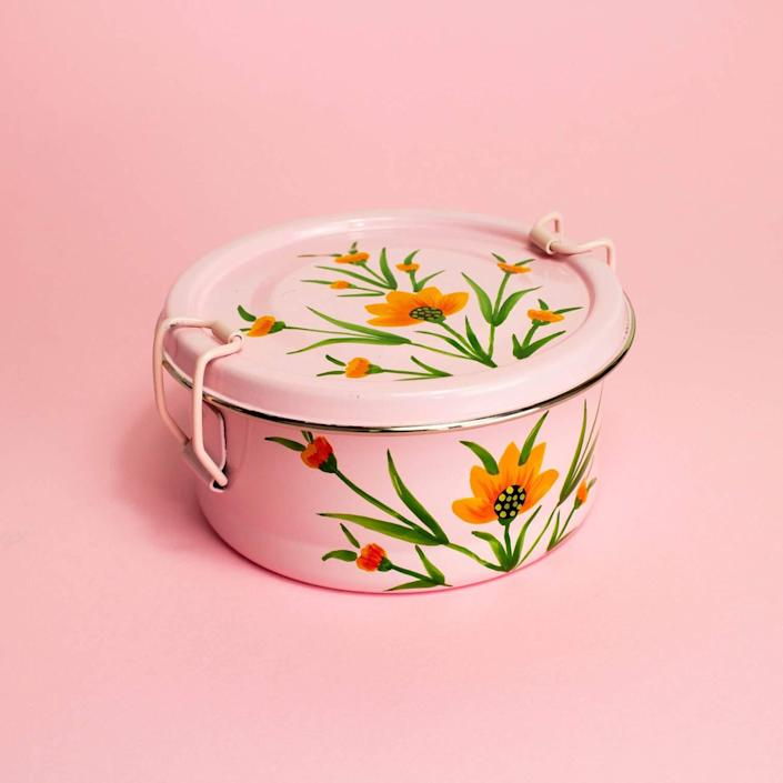 "<h2>GlobeIn Round Tiffin</h2><br><strong>Resolution: Refresh Your Space</strong><br>When revamping your living space, sometimes the most essentials elements are the non-essentials, like this festive tin. Although you don't <em>really</em> need it, the pink hue and floral accents can light up a room and inspire you to bring more joy into your life. Is it a stretch? Maybe. But is it worth a try? Definitely. <strong><br></strong><br><em>Shop</em> <strong><em><a href=""https://shop.globein.com/collections/vendors?q=Noah%27s%20Ark"" rel=""nofollow noopener"" target=""_blank"" data-ylk=""slk:Noah's Ark"" class=""link rapid-noclick-resp"">Noah's Ark</a></em></strong><br><br><strong>Noah's Ark</strong> Round Tiffin - Pink Floral, $, available at <a href=""https://go.skimresources.com/?id=30283X879131&url=https%3A%2F%2Fshop.globein.com%2Fcollections%2Fbest-sellers%2Fproducts%2Fround-pink-floral"" rel=""nofollow noopener"" target=""_blank"" data-ylk=""slk:GlobeIn"" class=""link rapid-noclick-resp"">GlobeIn</a>"