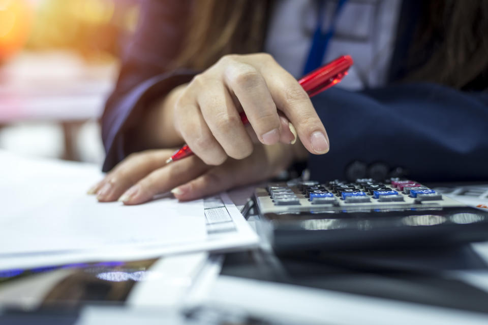 Hands of bank officer calculating loans