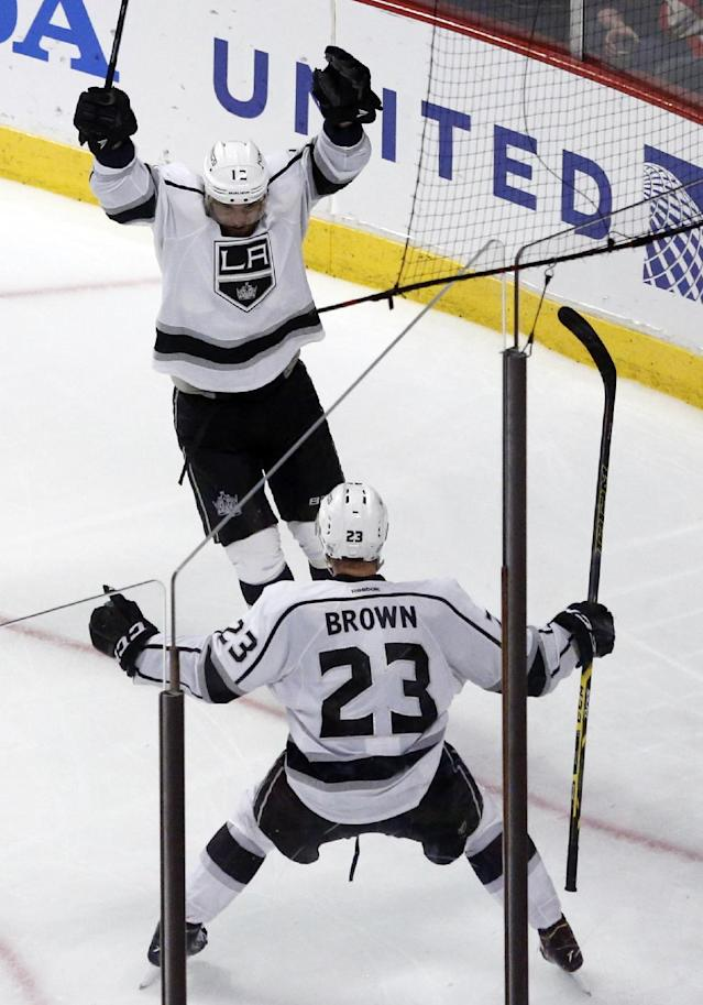 Los Angeles Kings right wing Marian Gaborik celebrates with right wing Dustin Brown (23) after scoring a goal against the Chicago Blackhawks during the third period in Game 7 of the Western Conference finals in the NHL hockey Stanley Cup playoffs Sunday, June 1, 2014, in Chicago. (AP Photo/Charles Rex Arbogast)