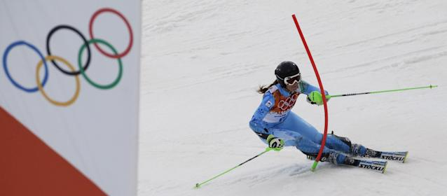 Slovenia's Tina Maze skis past a gate during the women's slalom at the Sochi 2014 Winter Olympics, Friday, Feb. 21, 2014, in Krasnaya Polyana, Russia. (AP Photo/Gero Breloer)
