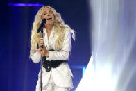 """Carrie Underwood performs """"I Wanna Remember"""" with NEEDTOBREATHE at the CMT Music Awards on Wednesday, May 5, 2021, in Nashville, Tenn. The awards show airs on June 9 with both live and prerecorded segments. (AP Photo/Mark Humphrey)"""