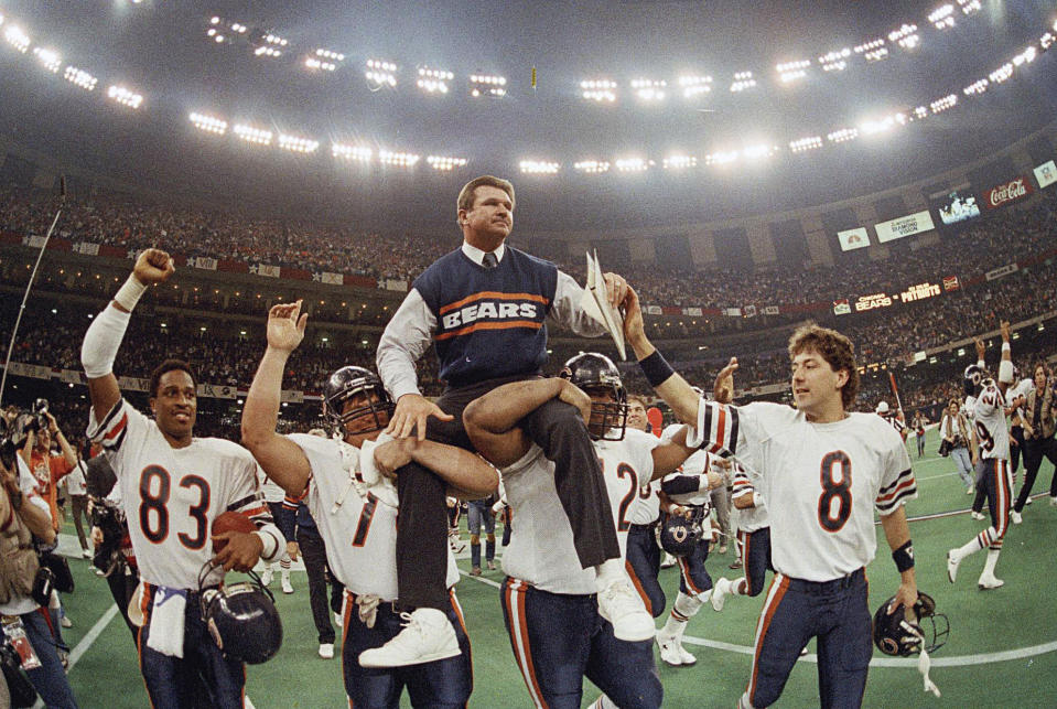 Chicago Bears coach Mike Ditka is carried off the field by Steve McMichael, left, and William Perry after the Bears defeated the New England Patriots 46-10 in Super Bowl XX. (AP Photo/Phil Sandlin, File)