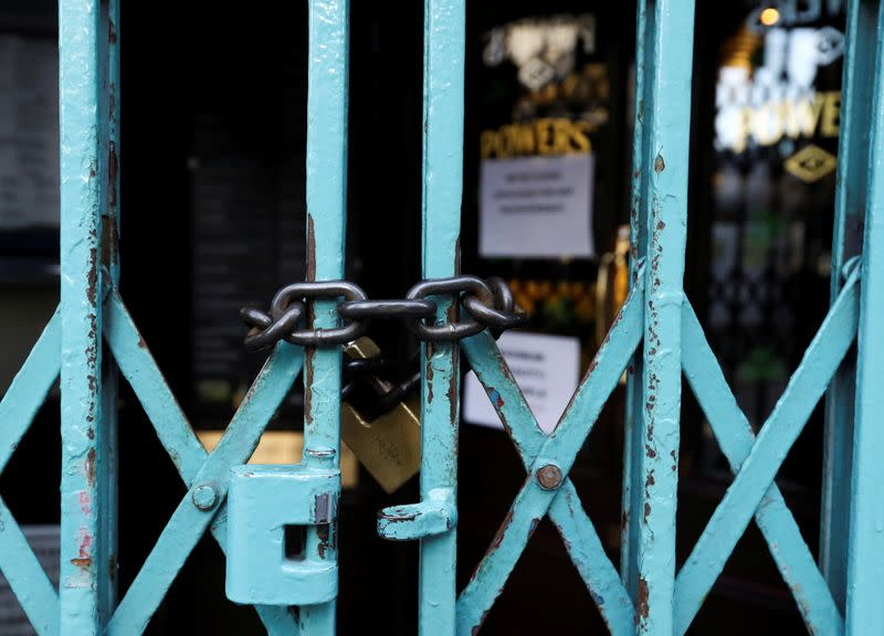 Pub doors are locked in the Temple Bar area of Dublin, as bars across Ireland are to close voluntarily to curb the spread of coronavirus in Dublin