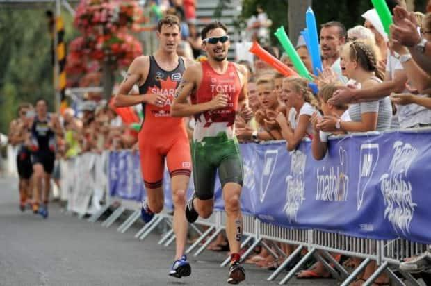 Canada's Matthew Sharpe, who turns 30 in July 2021, races in the running portion of a recent international triathlon event. (World Triathlon - image credit)