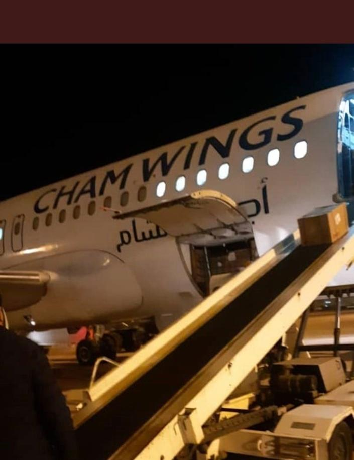 A Cham Wings plane delivering aid in Libya (World Health Organization)