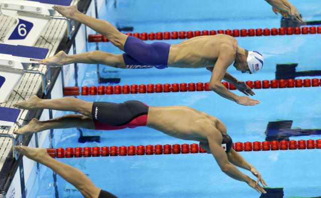 FILE - In this Wednesday, Aug. 10, 2016 file photo, United States' Michael Phelps, top, and Japan's Hiromasa Fujimori compete in a heat of the men's 200-meter individual medley during the swimming competitions at the 2016 Summer Olympics. Fujimori lost his appeal Friday, March 6, 2020 against a two-year ban for a positive doping test and will miss the Tokyo Olympics. (AP Photo/Matt Slocum, File)