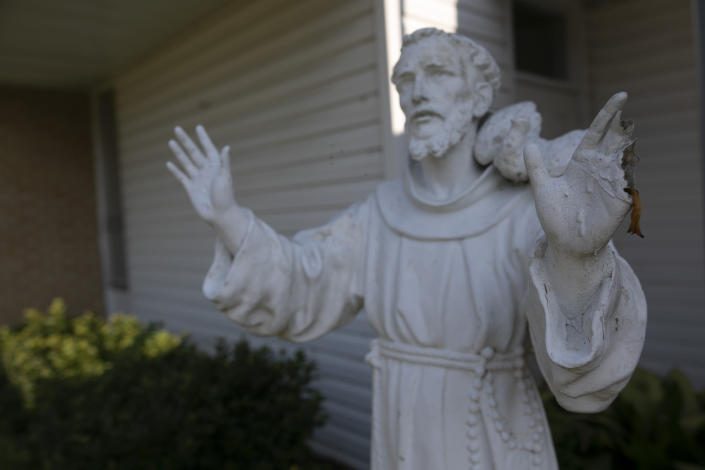 A stature of St. Francis of Assisi at the entrance of the church and school that bear his name in Greenwood, Miss., Monday, June 10, 2019. Franciscan friars have been working in Greenwood since the 1950s. (AP Photo/Wong Maye-E)