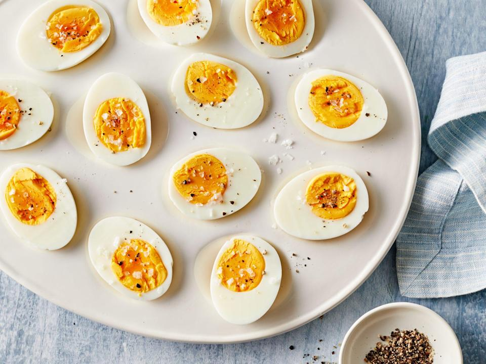 """<p><strong>Recipe: <a href=""""https://www.southernliving.com/recipes/perfect-hard-boiled-eggs"""" rel=""""nofollow noopener"""" target=""""_blank"""" data-ylk=""""slk:Perfect Hard Boiled Eggs"""" class=""""link rapid-noclick-resp"""">Perfect Hard Boiled Eggs</a></strong></p> <p>Skipping breakfast? Not an option. Make up a batch of these perfect hard-boiled eggs for busy mornings so you're never left without a quick grab-and-go option. Each recipe makes six hard-boiled eggs.</p>"""