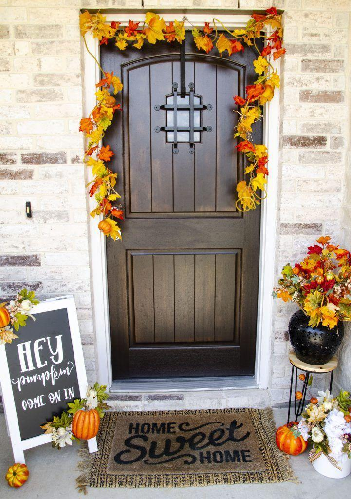 """<p>A chalkboard sign gives you the flexibility to change out welcome message as frequently as you'd like. </p><p><a class=""""link rapid-noclick-resp"""" href=""""https://love-the-day.com/fall-pumpkin-decor"""" rel=""""nofollow noopener"""" target=""""_blank"""" data-ylk=""""slk:GET THE TUTORIAL"""">GET THE TUTORIAL</a></p>"""