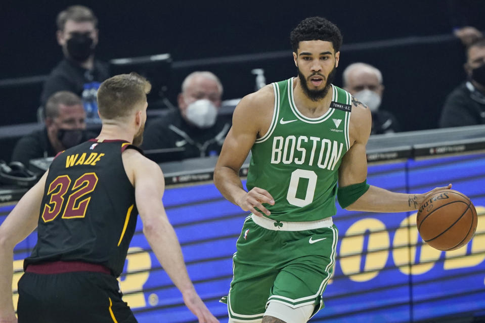 Boston Celtics' Jayson Tatum (0) drives against Cleveland Cavaliers' Dean Wade (32) in the first half of an NBA basketball game, Wednesday, May 12, 2021, in Cleveland. (AP Photo/Tony Dejak)