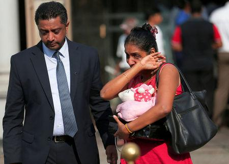 Devotees cry in front of St Anthony's church in Colombo