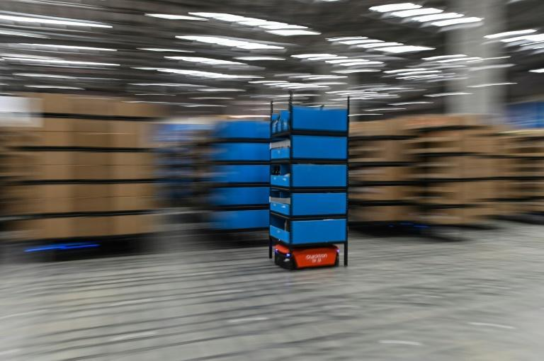 A blue robot moves between aisles at the Wuxi warehouse of Cainiao Smart Logistics Network, an affiliate of e-commerce giant Alibaba, ahead of Singles Day