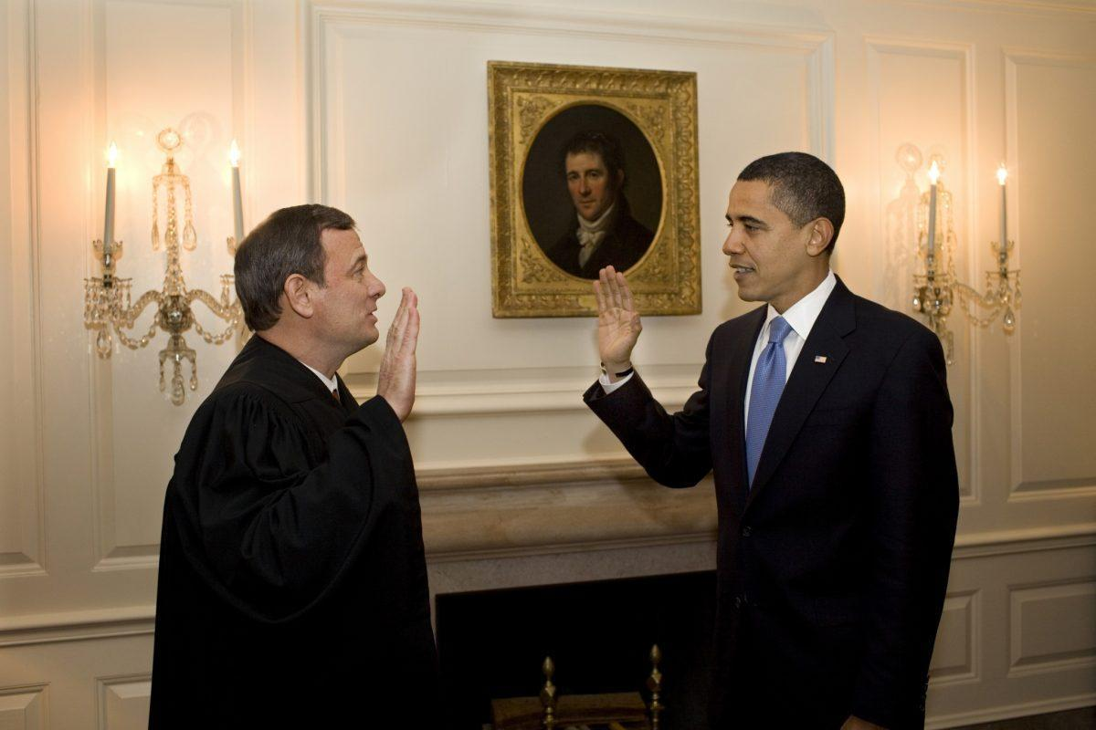 Chief Justice John G. Roberts Jr. administers the oath of office to President Barack Obama a second time in the Map Room of the White House January 21, 2009 in Washington, DC. (Photo by Pete Souza/The White House via Getty Images)