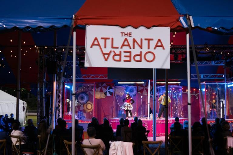"People perform in plastic boxes on stage during The Atlanta Opera's production of ""Pagliacci"" on October 22, 2020"