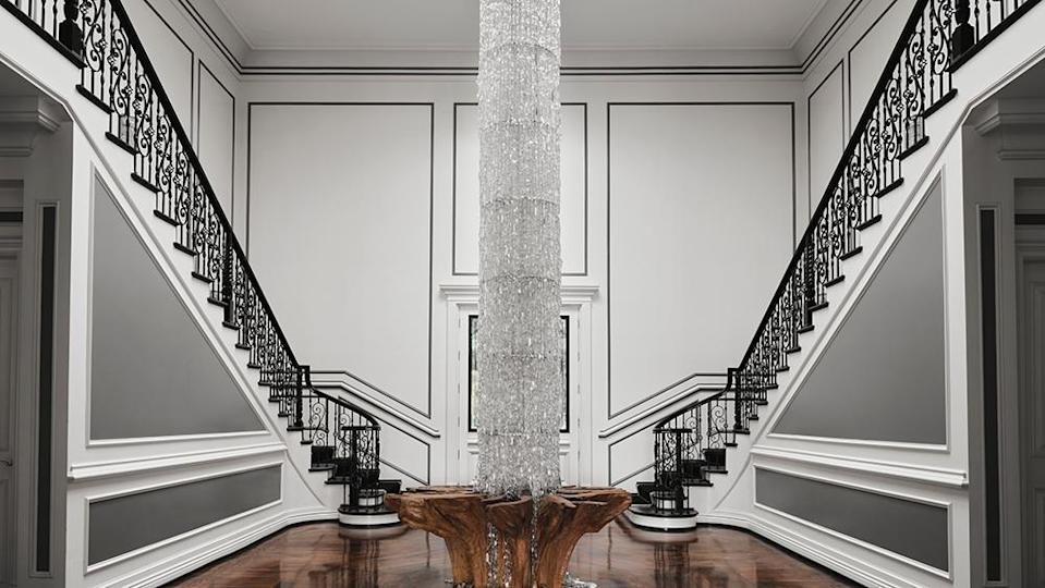The foyer, which features a floor-to-ceiling Swarovski chandelier - Credit: Photo: Courtesy of Douglas Friedman
