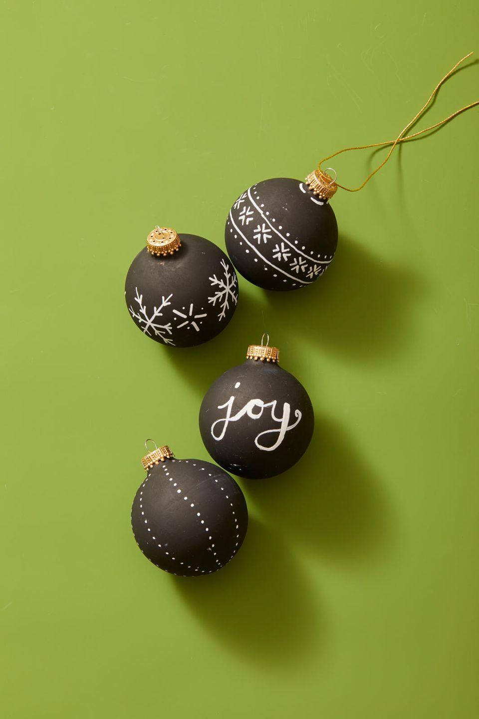 """<p>Custom-make your own ornaments by painting them with <a href=""""https://www.amazon.com/Chalkboard-American-Crafts-ounces-366867/dp/B00I99S3BC/?tag=syn-yahoo-20&ascsubtag=%5Bartid%7C10055.g.2996%5Bsrc%7Cyahoo-us"""" rel=""""nofollow noopener"""" target=""""_blank"""" data-ylk=""""slk:chalk paint"""" class=""""link rapid-noclick-resp"""">chalk paint</a>, then writing on them with a <a href=""""https://www.amazon.com/Sanford-35558-Sharpie-Oil-Based-1-Count/dp/B001PLKRZQ?tag=syn-yahoo-20&ascsubtag=%5Bartid%7C10055.g.2996%5Bsrc%7Cyahoo-us"""" rel=""""nofollow noopener"""" target=""""_blank"""" data-ylk=""""slk:white paint pen"""" class=""""link rapid-noclick-resp"""">white paint pen</a>. You can doodle on a holiday design, or personalize them with your names and special dates (birthdays, anniversaries, and so on). </p><p><strong>RELATED: </strong><a href=""""https://www.goodhousekeeping.com/holidays/christmas-ideas/g393/homemade-christmas-ornaments/"""" rel=""""nofollow noopener"""" target=""""_blank"""" data-ylk=""""slk:Homemade Christmas Ornaments to Easily Personalize Your Tree"""" class=""""link rapid-noclick-resp"""">Homemade Christmas Ornaments to Easily Personalize Your Tree</a></p>"""