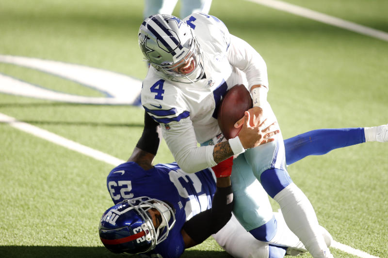 Dallas Cowboys quarterback Dak Prescott is tackled and injured by New York Giants cornerback Logan Ryan.