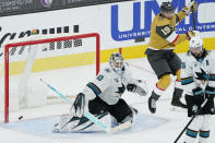 Vegas Golden Knights right wing Reilly Smith (19) jumps out of the way as Vegas Golden Knights defenseman Nicolas Hague, not pictured, scores on San Jose Sharks goaltender Devan Dubnyk (40) during the third period of an NHL hockey game Wednesday, March 17, 2021, in Las Vegas. (AP Photo/John Locher)