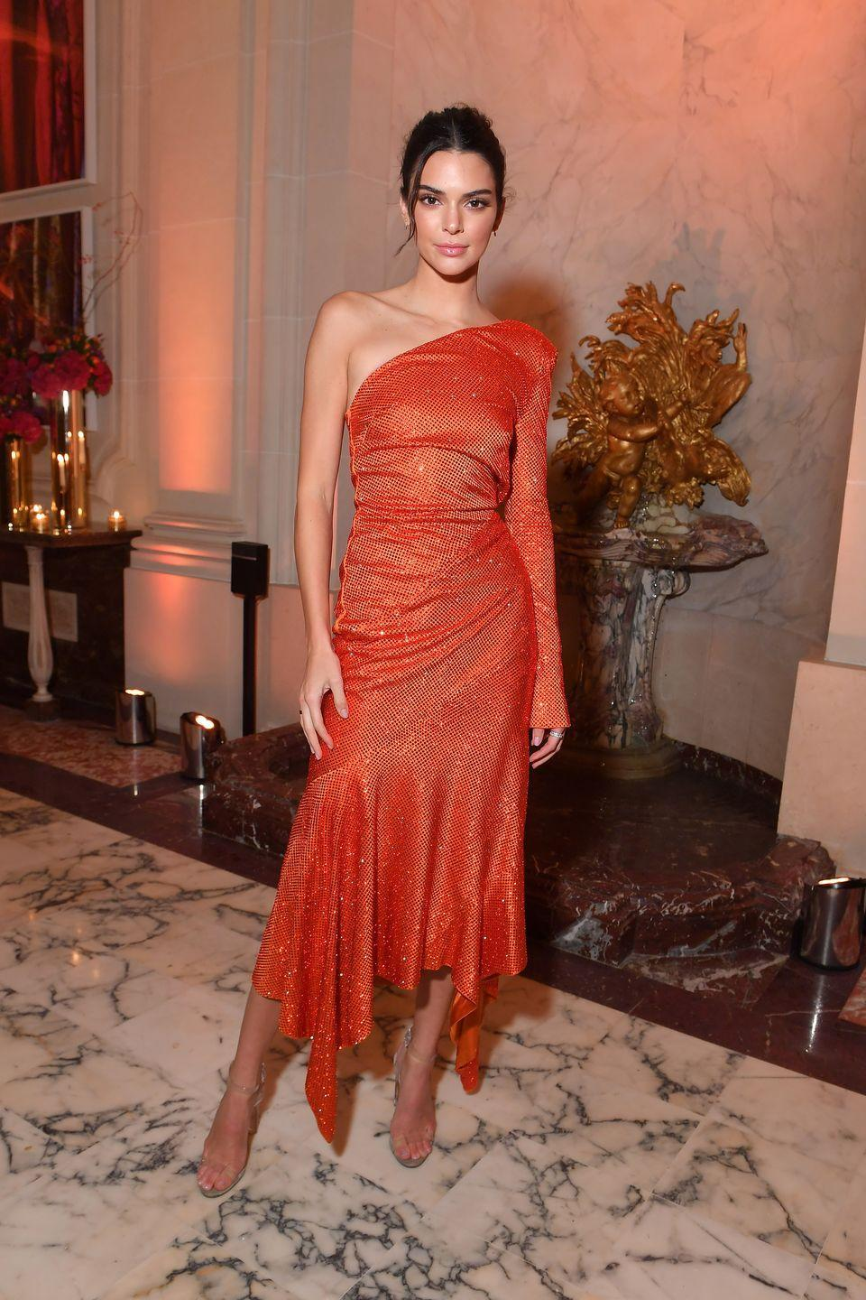 <p>The model wore a red Alexandre Vauthier dress to the party during during Paris Fashion Week, September 2018.</p>