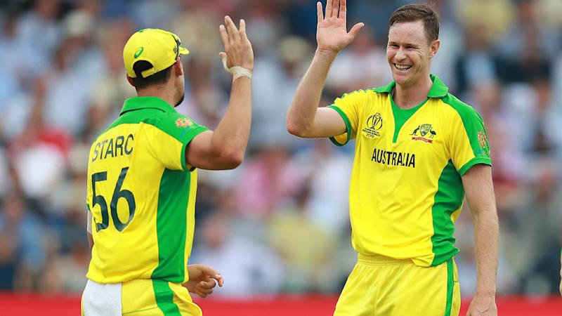 Jason Behrendorff celebrates with Mitchell Starc. (Photo by David Rogers/Getty Images)