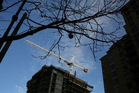 FILE PHOTO - A crane towers over a condominium construction site in Toronto
