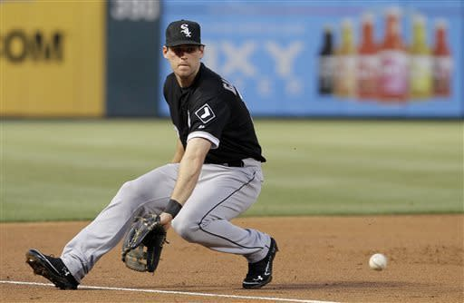 Chicago White Sox third baseman Conor Gillaspie fields a foul ball hit by Texas Rangers' Adrian Beltre (29) in the third inning of a baseball game in Arlington, Texas, Wednesday, May 1, 2013. (AP Photo/Brandon Wade)