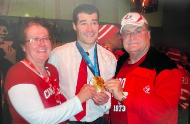 Marleau poses with his parents, Jeanette and Denis, after winning a gold medal at the 2010 Vancouver Olympic Games.