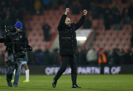 Manchester City manager Pep Guardiola celebrates after the game