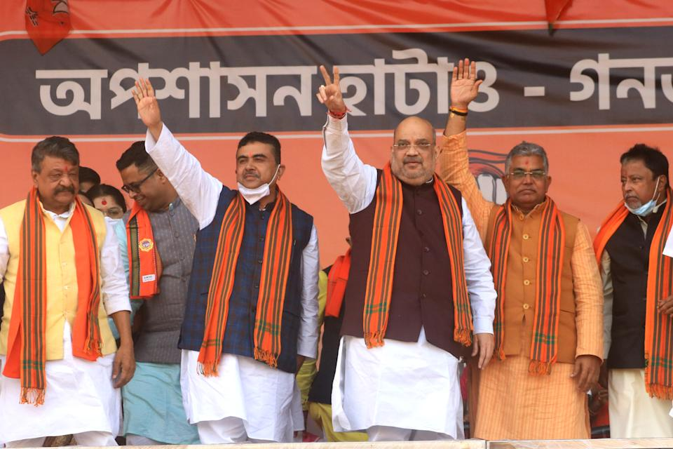 Union Home Minister Amit Shah is seen along with West Bengal political heavyweight Suvendu Adhikari  joined the BJP along BJP Senior Leader Kailash Vijoyborgiya, West Bengal BJP President Dilip Ghosh ,Mukul Roy,Locket Chatterjee,Arjun Singh and others at a public rally in Midnapore ,India ,Saturday,December 19,2020. (Photo by Debajyoti Chakraborty/NurPhoto via Getty Images)