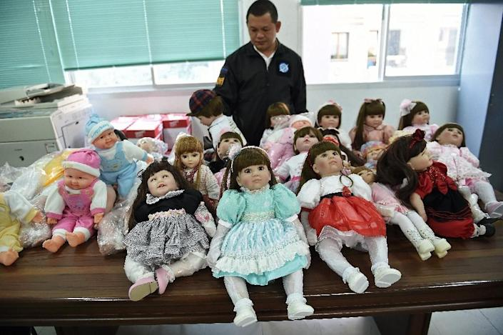 Thai police found one doll packed with 200 methamphetamine pills (AFP Photo/Christophe Archambault)