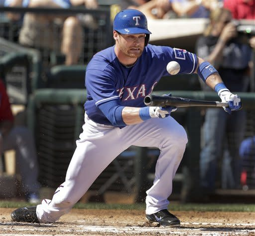 Texas Rangers' Craig Gentry bunts into a force-out during the second inning of an exhibition spring training baseball game against the Chicago Cubs, Wednesday, March 6, 2013, in Surprise, Ariz. (AP Photo/Charlie Riedel)