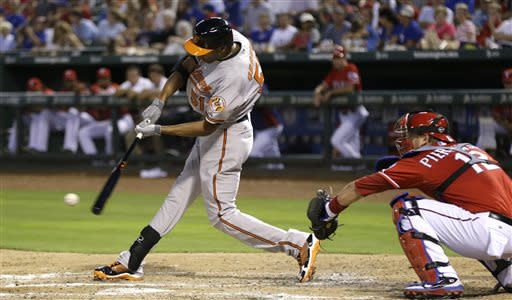 Baltimore Orioles' Henry Urrutia, left, swings for his first hit in the majors, an RBI single, in front of Texas Rangers catcher A.J. Pierzynski during the third inning of a baseball game Saturday, July 20, 2013, in Arlington, Texas. (AP Photo/LM Otero)